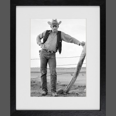 Frank Worth: James Dean Standing at fence Set of Giant 1955