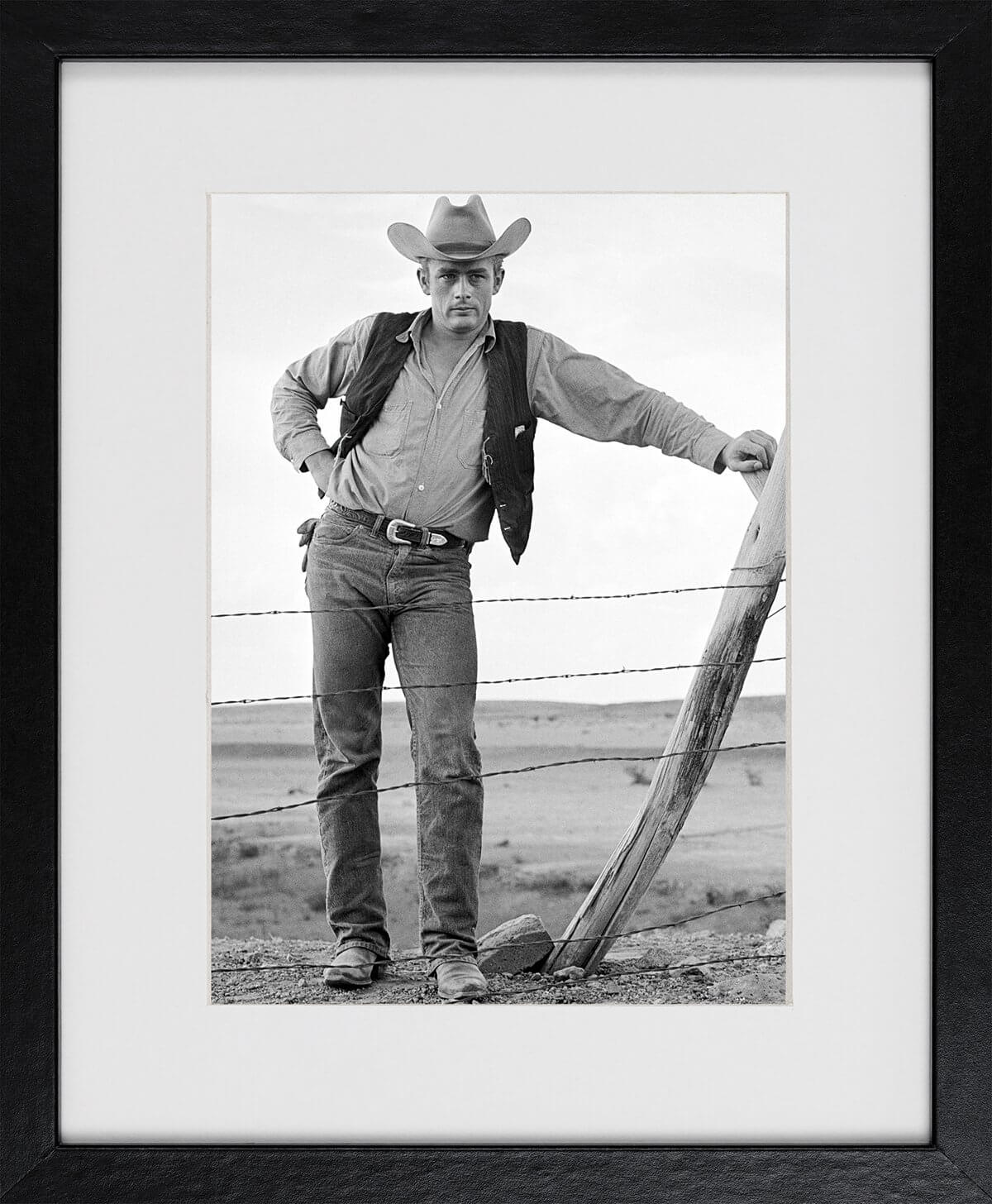 Frank Worth: James Dean standing at fence Set of Giant